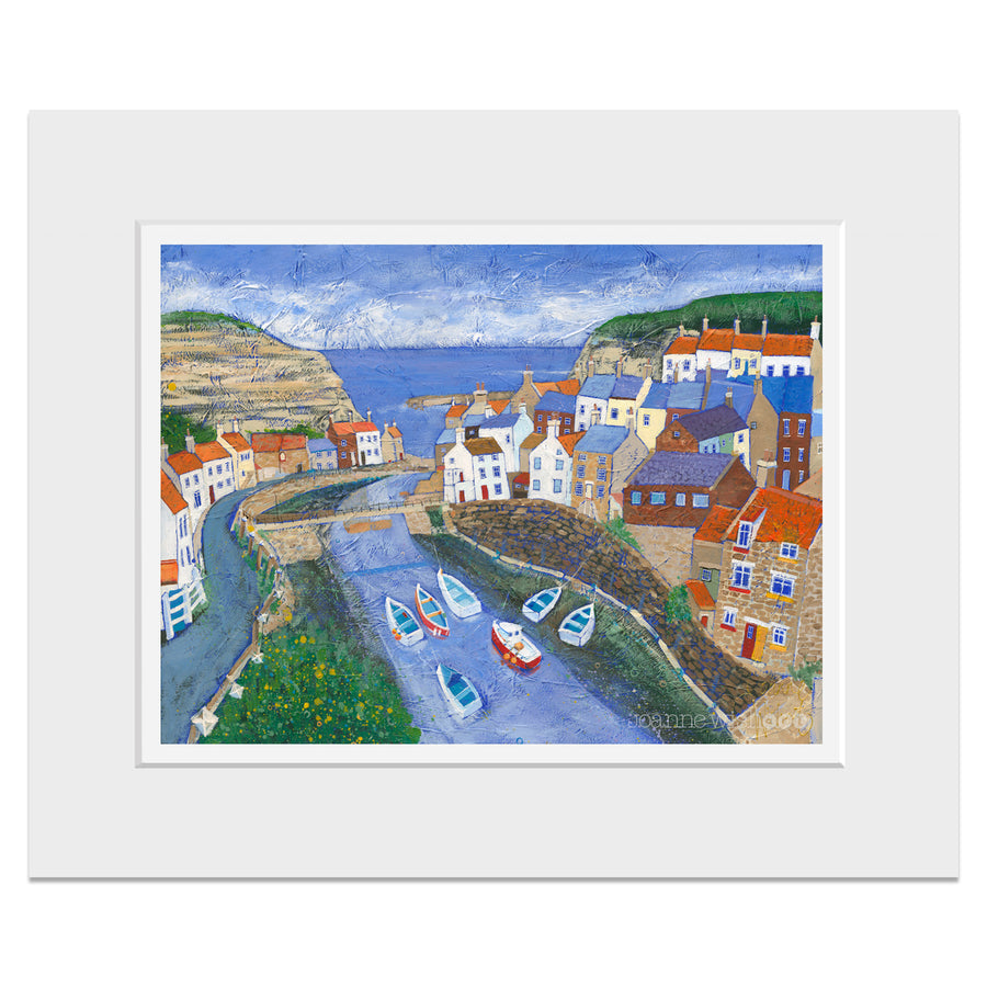 A mounted print of Staithes village looking down the beck.