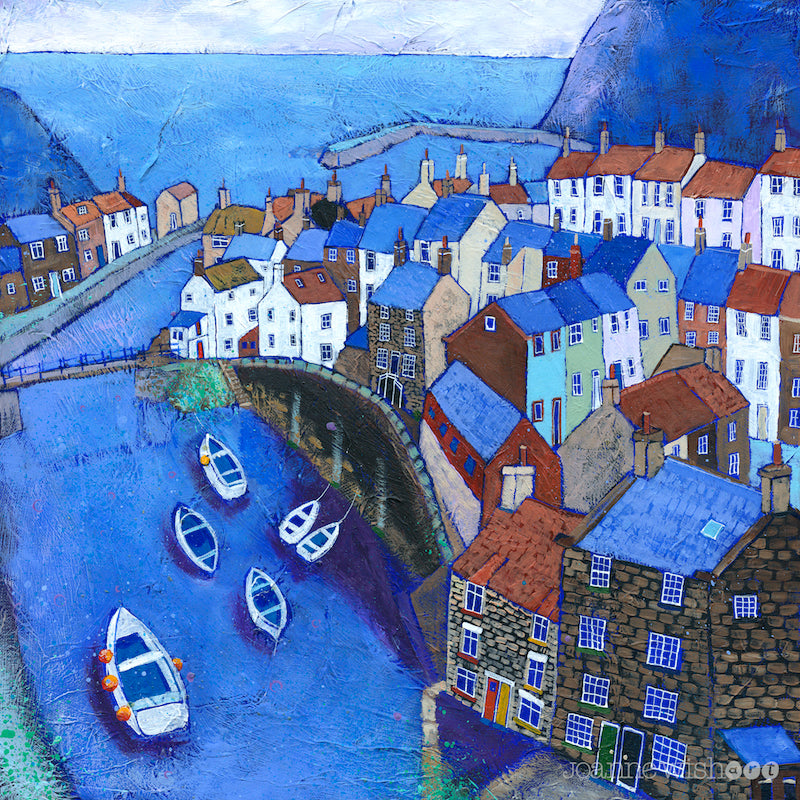 A print of Staithes village featuring topsy turvy houses on the cliffside with the boat filled beck leading out to sea.