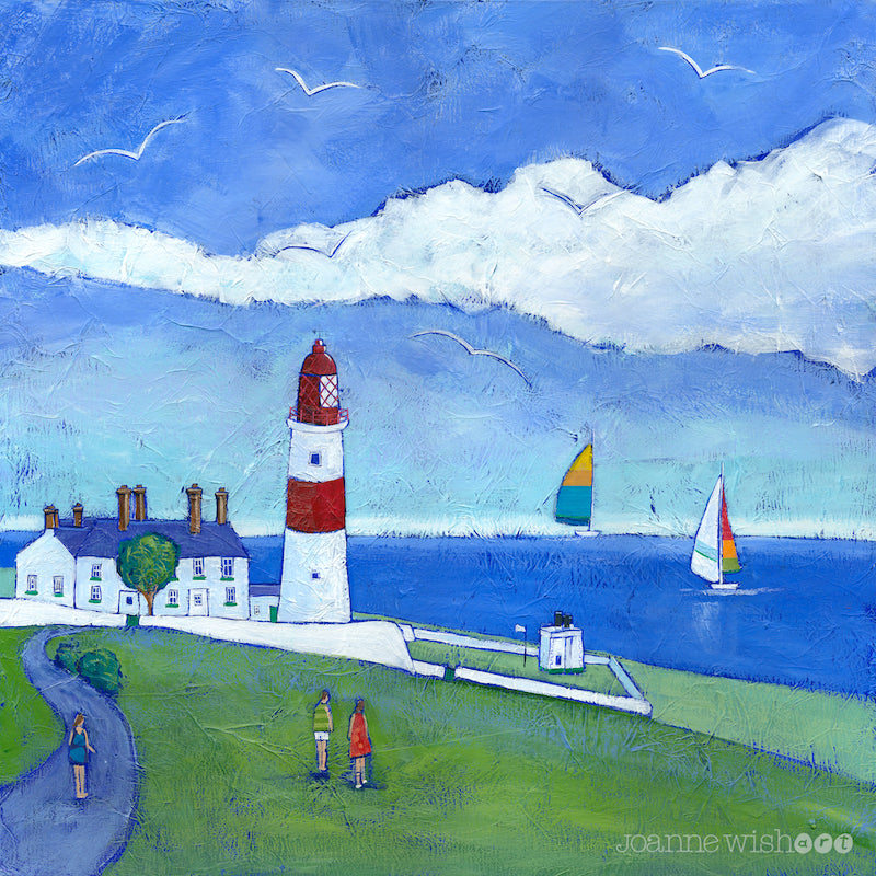A colourful print of Souter lighthouse with sailing boats cruising on the water .