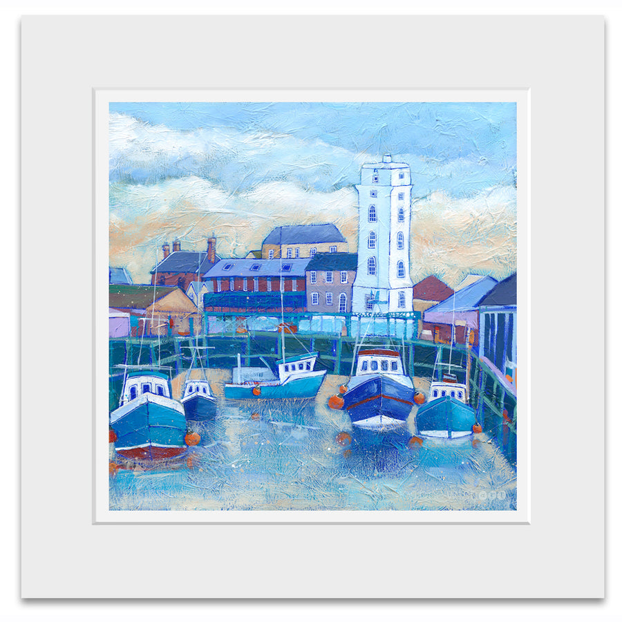 A mounted art print of North shields fish quay with a winter sky.