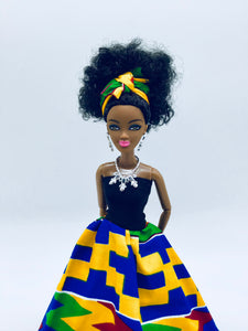 Black Princess doll with curly hair and Ankara dress