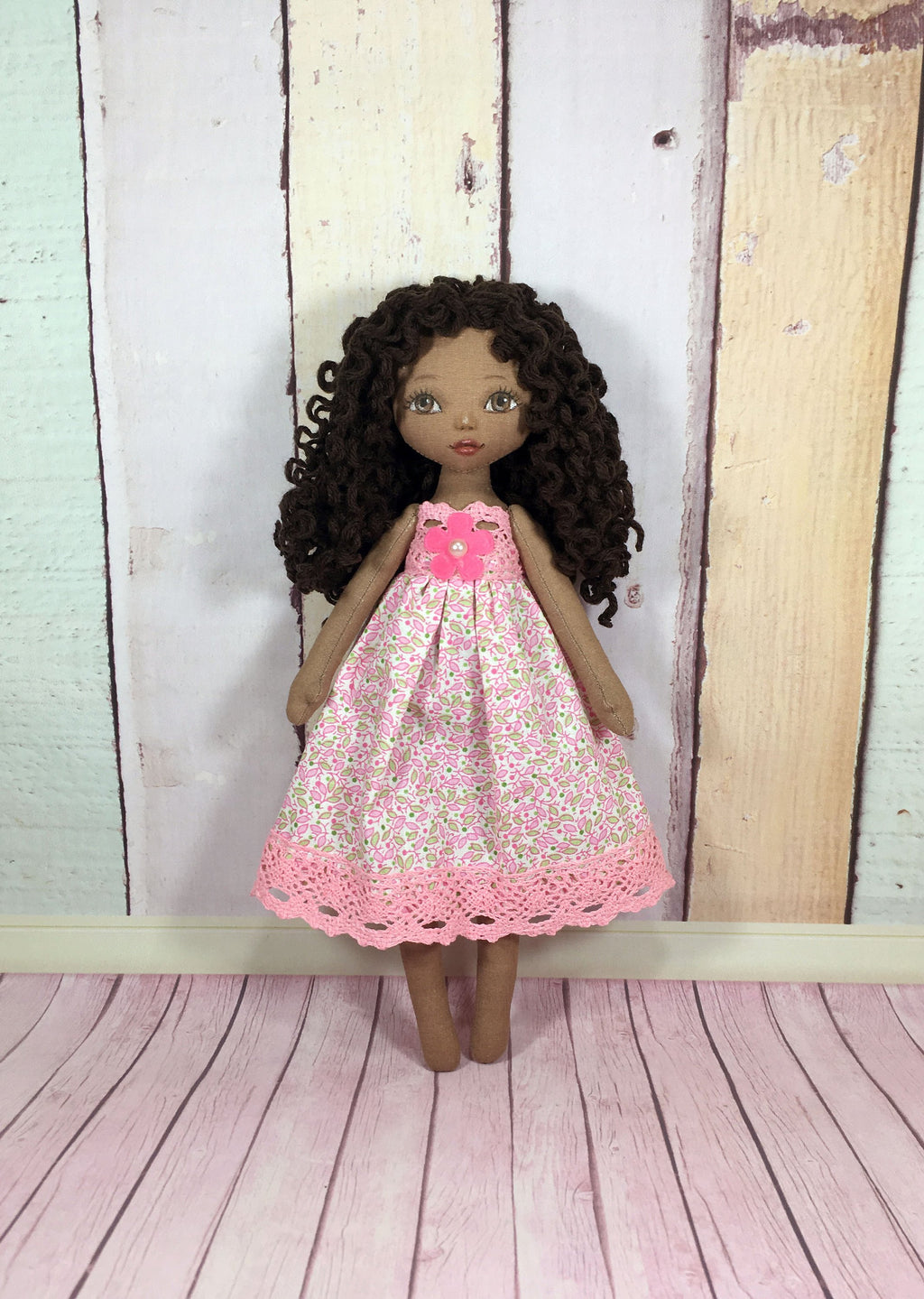 little black tilda doll in pink dress