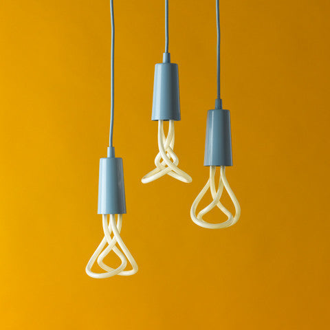 Plumen 001 designer light bulb in pastel blue Drop Cap lighting pendant