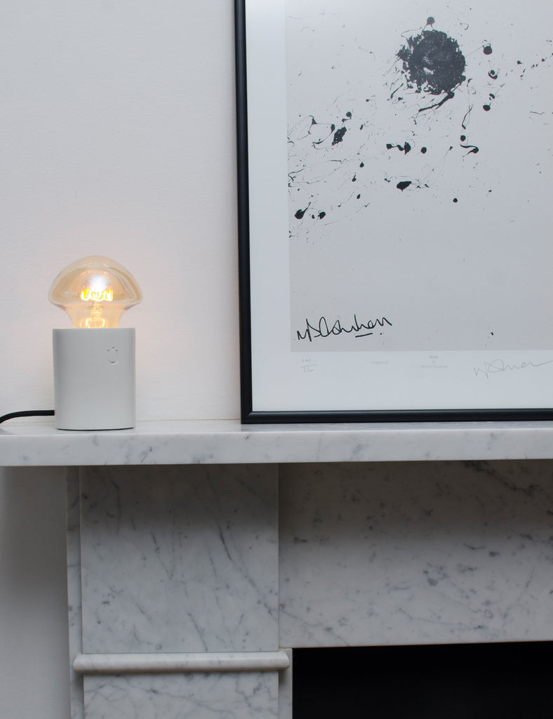 wilma bulb lumi concrete lamp on fireplace