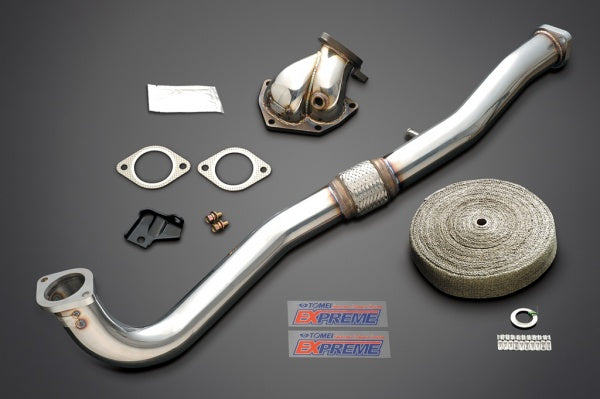 Tomei Outlet Component including dump, front pipe, heat wrap, bolts, nuts and gaskets.