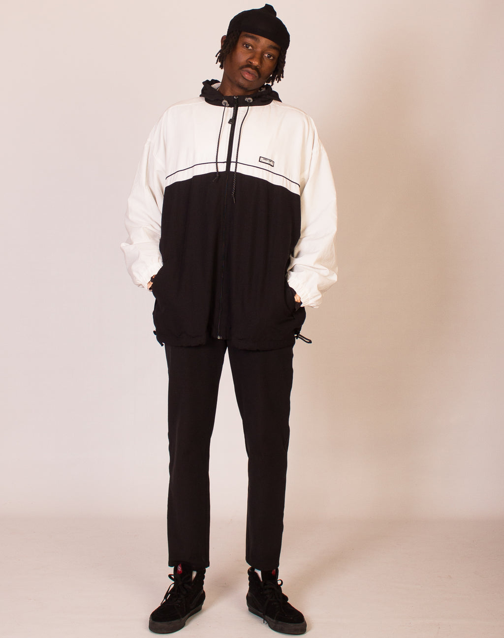 REEBOK BLACK AND WHITE WINDBREAKER