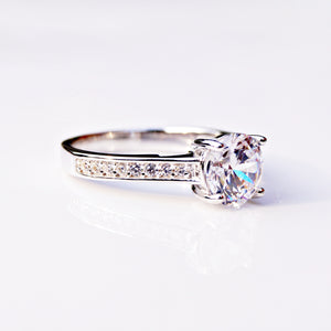 Solitaire Ring with Accent and Surprise Diamonds