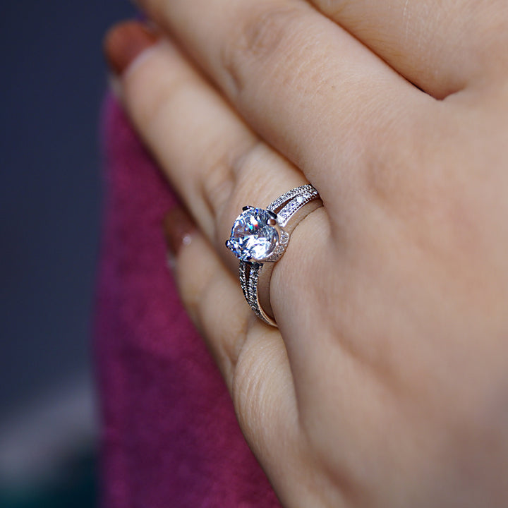 Solitaire Ring with Double Accent and Surprise Diamonds