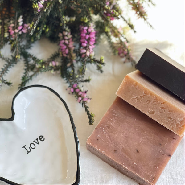 Love Bath Bar Trio displayed with love tray and flowers