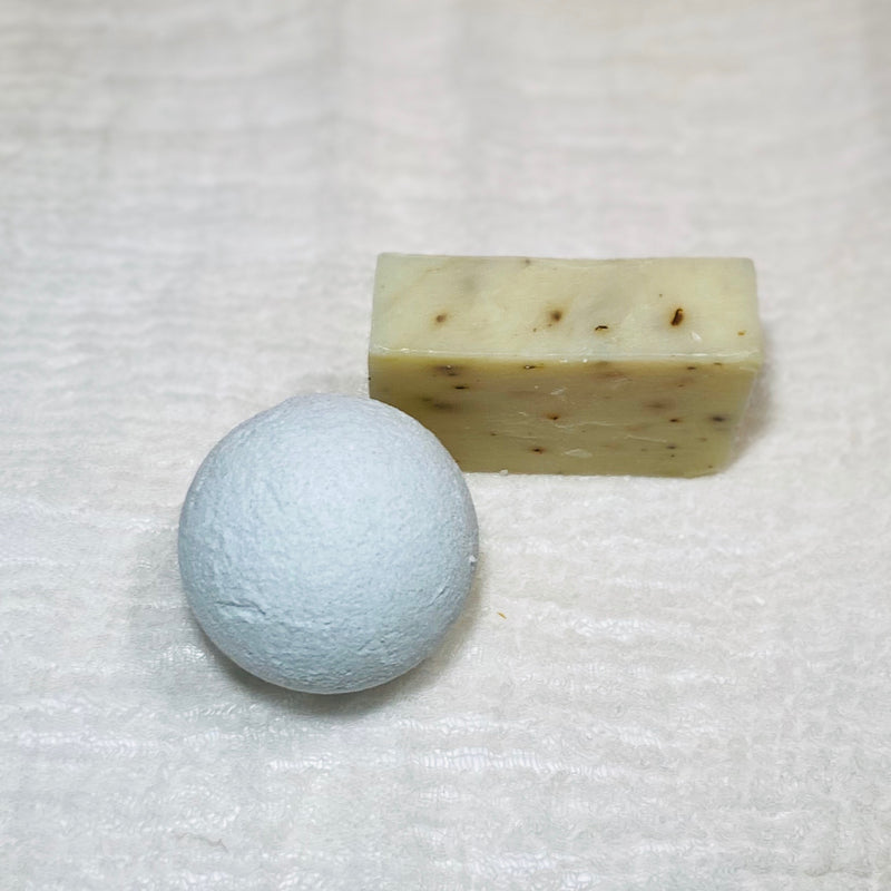refreshing cleanse bath bomb and soap displayed on gauze
