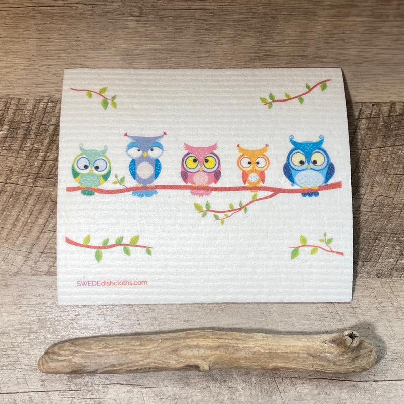 Natural cloth displays colorful owls on a tree branch