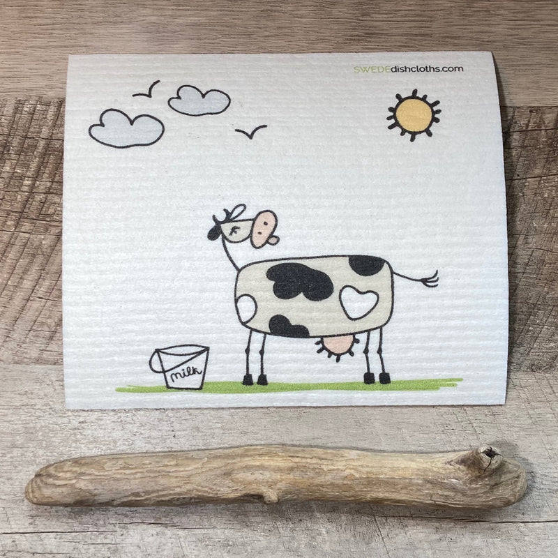 Natural cloth with whimsy cow a bucket of milk and the sun, birds and clouds