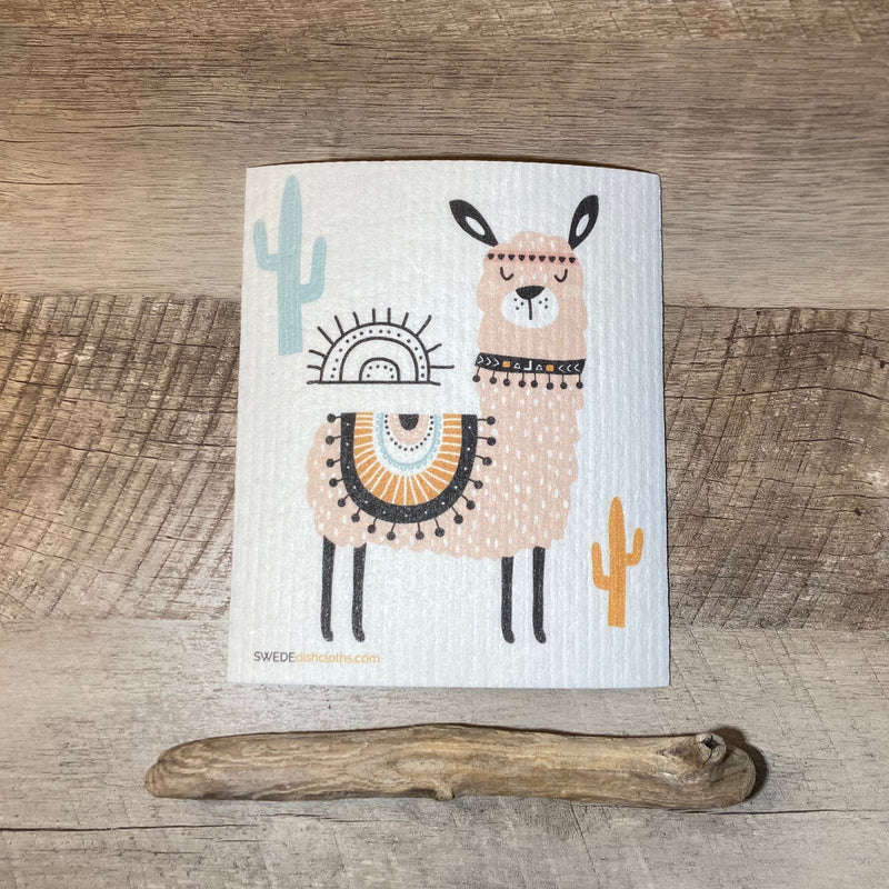 Natural Cloth with whimsical llama and cactus plants displayed with rustic birch wood..