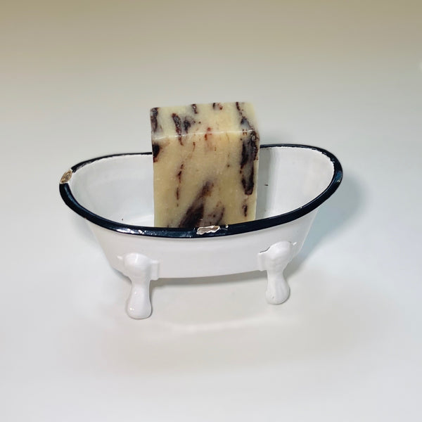 Canela Chocolate Bath Soap in vintage tub prop.