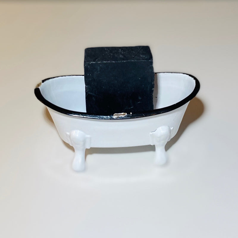 Lavender Activated Charcoal bath soap in a vintage tub prop.