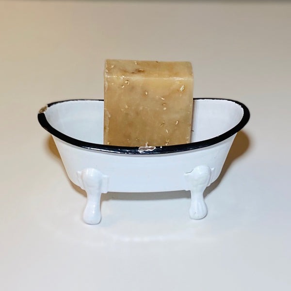 Lavender Goat Milk and Oats soap in a vintage tub prop.