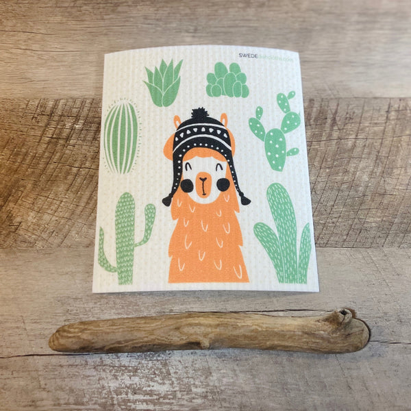 Orange Llama with winter hat and cactus