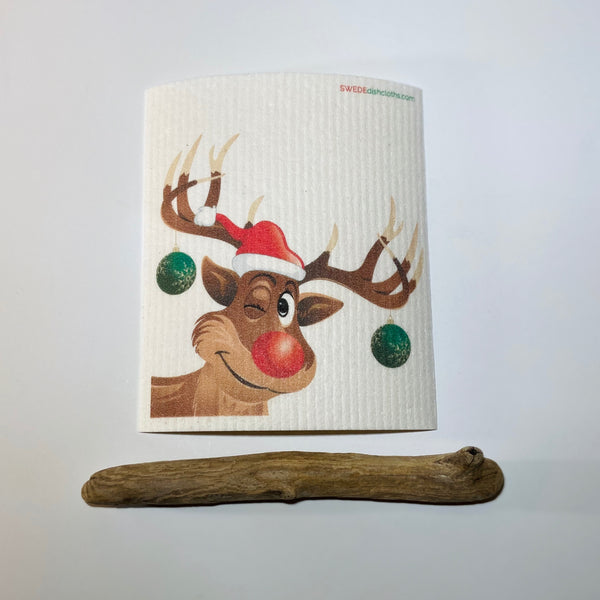Winking reindeer with santa hat and ornaments hanging from antlers