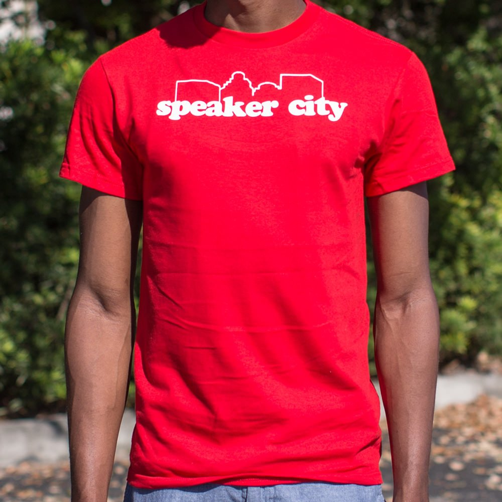 Red Speaker City T-Shirt (Mens) Small / Red,Medium / Red,Large / Red,X-Large / Red,2X-Large / Red,3X-Large / Red,Small / Red Heather,Medium / Red Heather,Large / Red Heather,X-Large / Red Heather,2X-Large / Red Heather,3X-Large / Red Heather,Small / Navy Heather,Medium / Navy Heather,Large / Navy Heather,X-Large / Navy Heather,2X-Large / Navy Heather,3X-Large / Navy Heather,Small / Kelly Green Heather,Medium / Kelly Green Heather,Large / Kelly Green Heather,X-Large / Kelly Green Heather,2X-Large / Kelly Gre