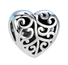swirly heart charm