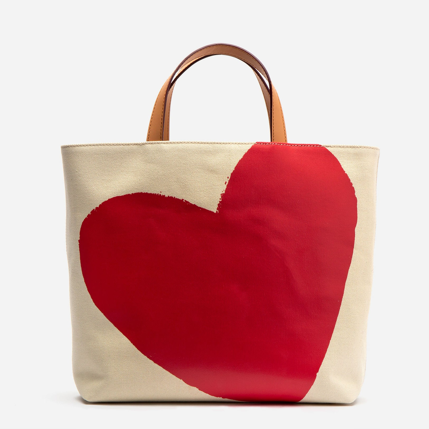 Large Margaret canvas bag with vachetta leather trim. Heart illustration by Margaret Cepis. Shop Frances Valentine.
