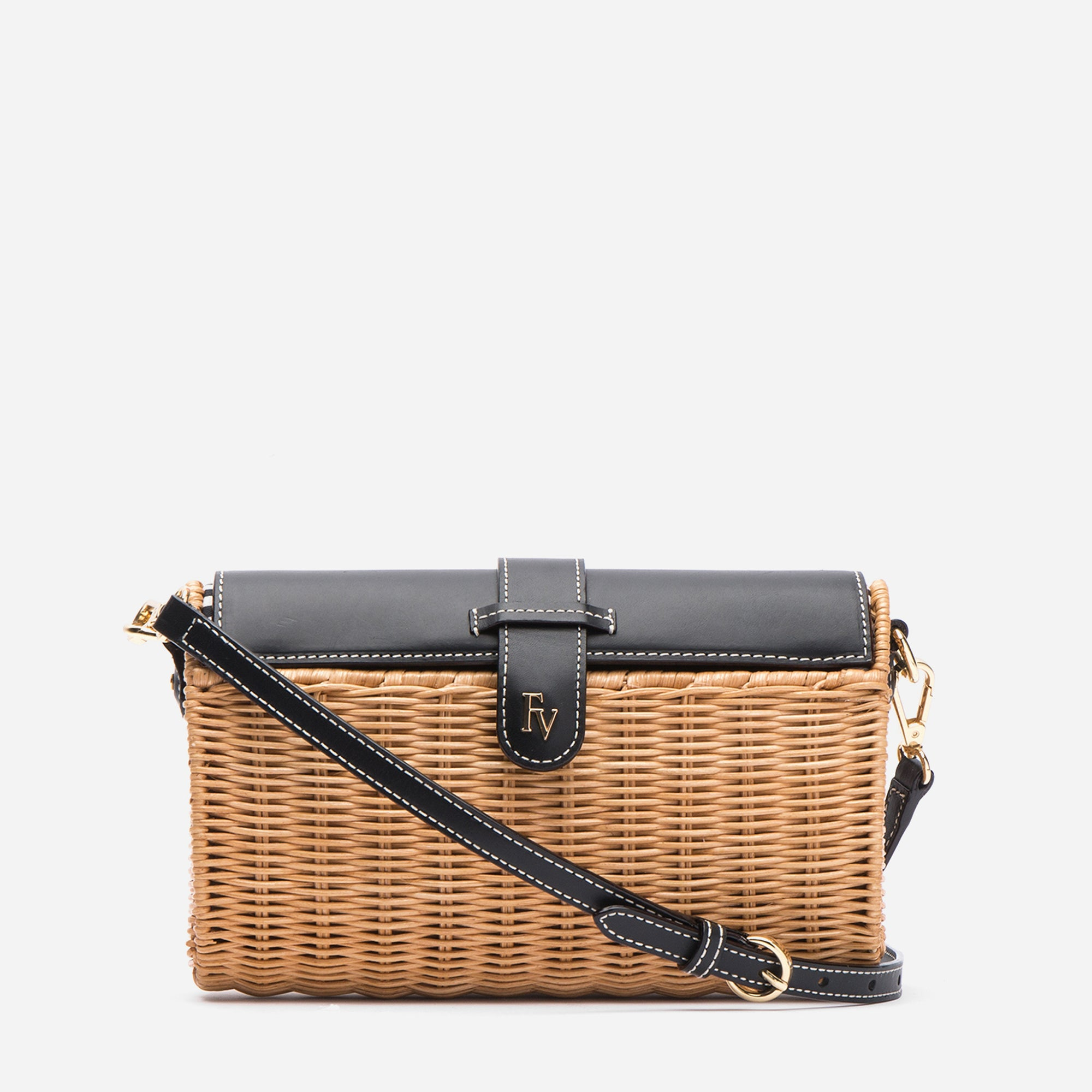 Woven wicker basket bag with vachetta leather accents and ticking stripe lining. Shop Frances Valentine.