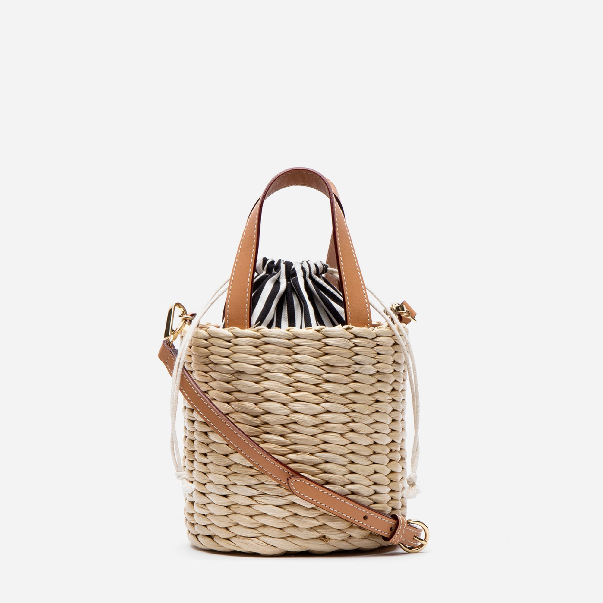 Small handwoven cornhusk bucket bag with striped interior. Shop Frances Valentine.