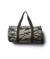 Day Tripper 29 Liter Duffle Bag made of durable polyester material with Nylon handles and removable shoulder strap in Tiger Camo