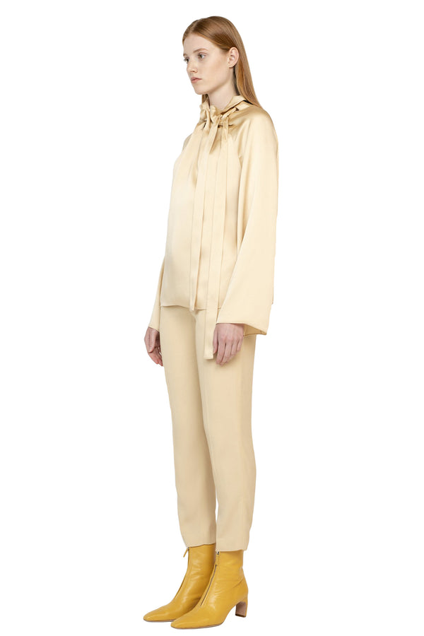 Cream top with tie neck design from Rosetta Getty