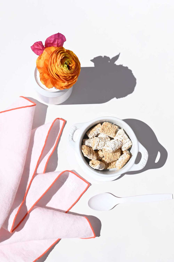 Blush Linen Napkins with orange accents | Atelier Saucier