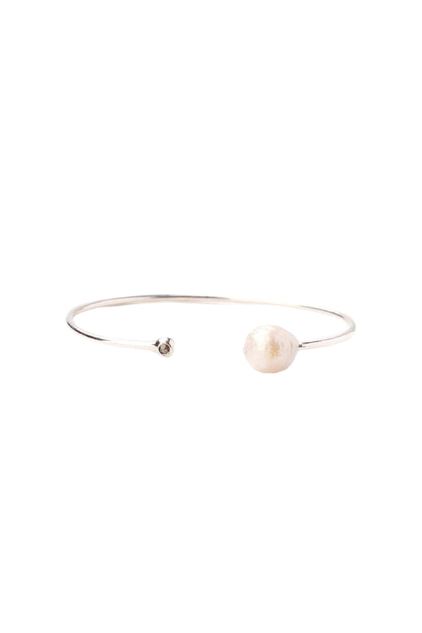 Silver cuff with grey pearl and champagne diamond by Chan Luu