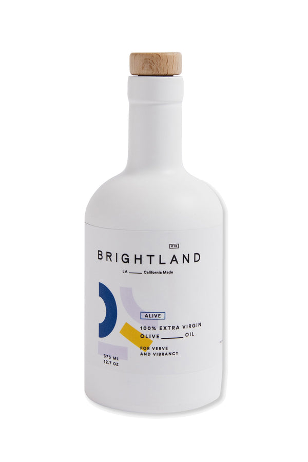 12.7 oz bottle of ALIVE olive oil by Brightland
