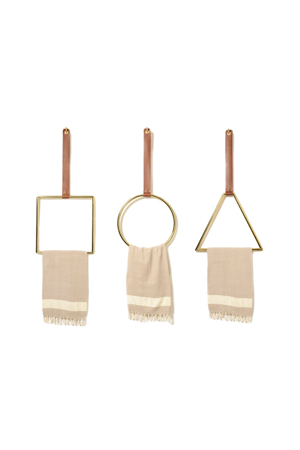 Leather strap geometric brass wall hanger by Anna Karlin