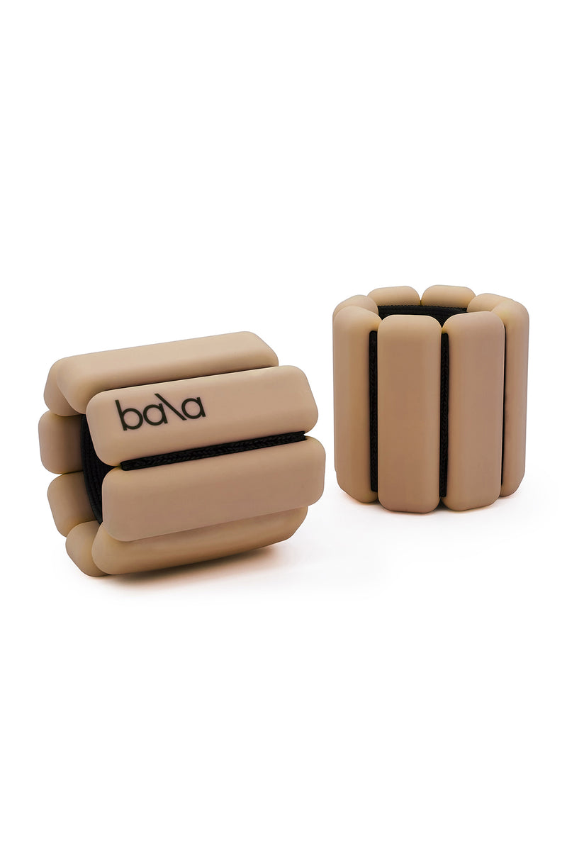 Beige wearable weights by Bala Bangles