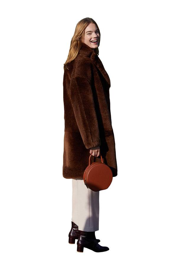 Dark brown shearling coat with leather interior from Mansur Gavriel