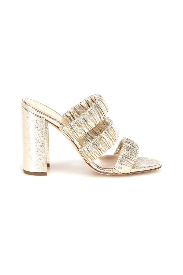 Gold three strap Delphinium heel by Chloe Gosselin