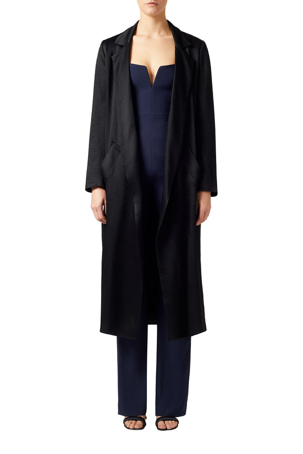 Textured black satin crêpe trench coat by Galvan London