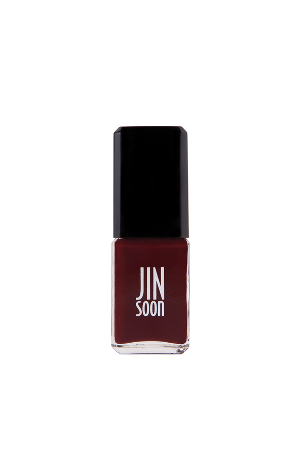 Dark red nail polish in a bottle by JinSoon