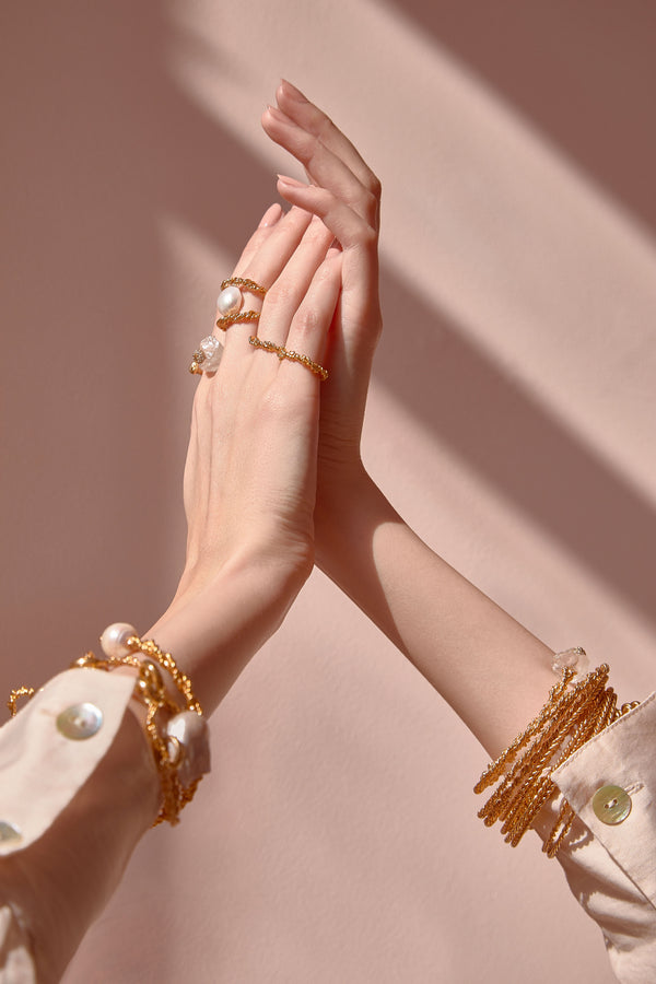 Model wearing Gold Plated Twisted Bangle With Pearls | Joanna Laura Constantine