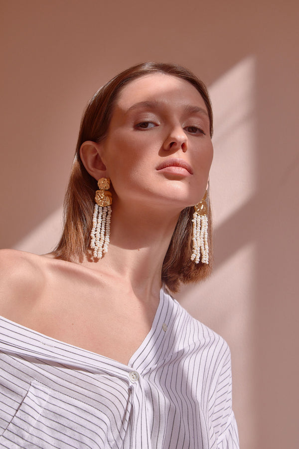Model Wearing Hammered Earrings with Dangling Pearls | Joanna Laura Constantine