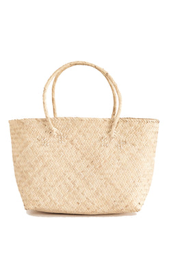 Small handwoven tan tote bag made from rattan from Bembien