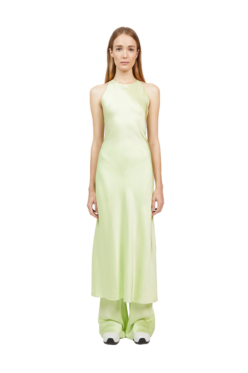 Front view of Lime colored Cross Back Slip Dress paired with matching Bias Trousers