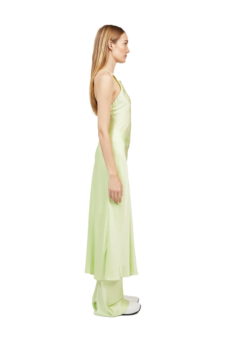 Side view of Lime colored Cross Back Slip Dress paired with matching Bias Trousers