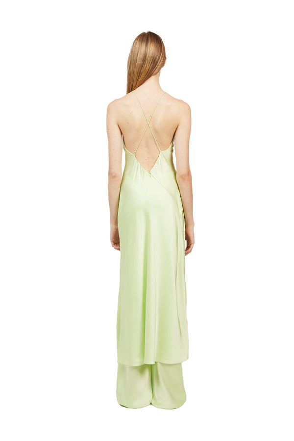Back view of Lime colored Cross Back Slip Dress paired with matching Bias Trousers
