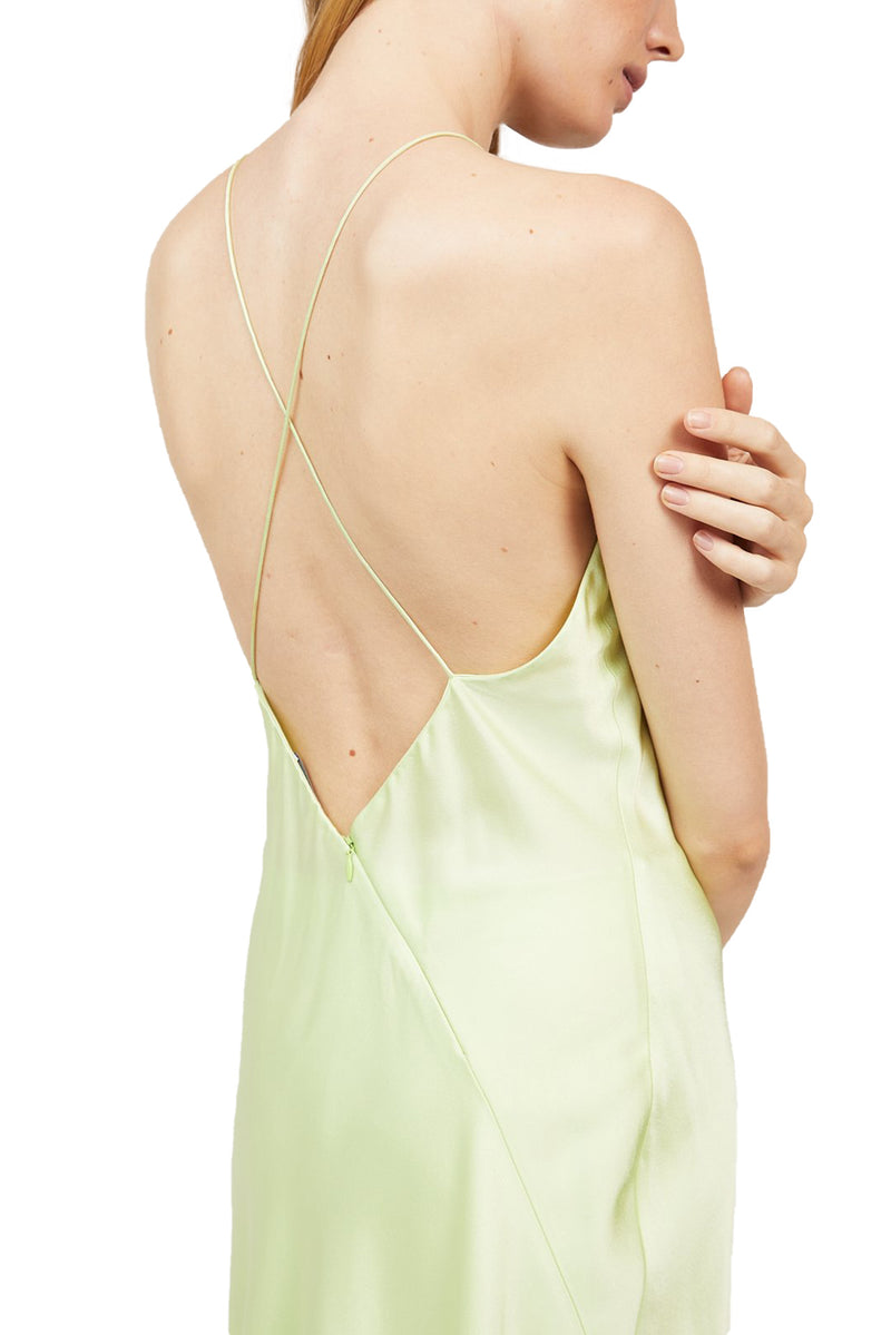 Angled back view of Lime colored Cross Back Slip Dress paired with matching Bias Trousers