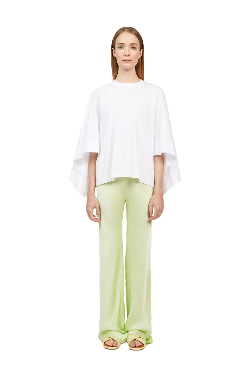 Front view Lime colored Bias Trousers paired with a white dress shirt