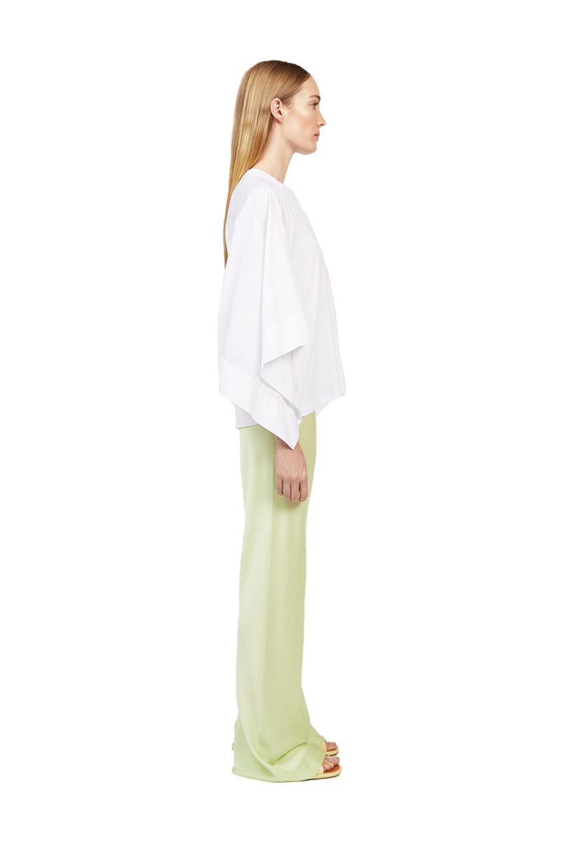 Side view Lime colored Bias Trousers paired with a white dress shirt