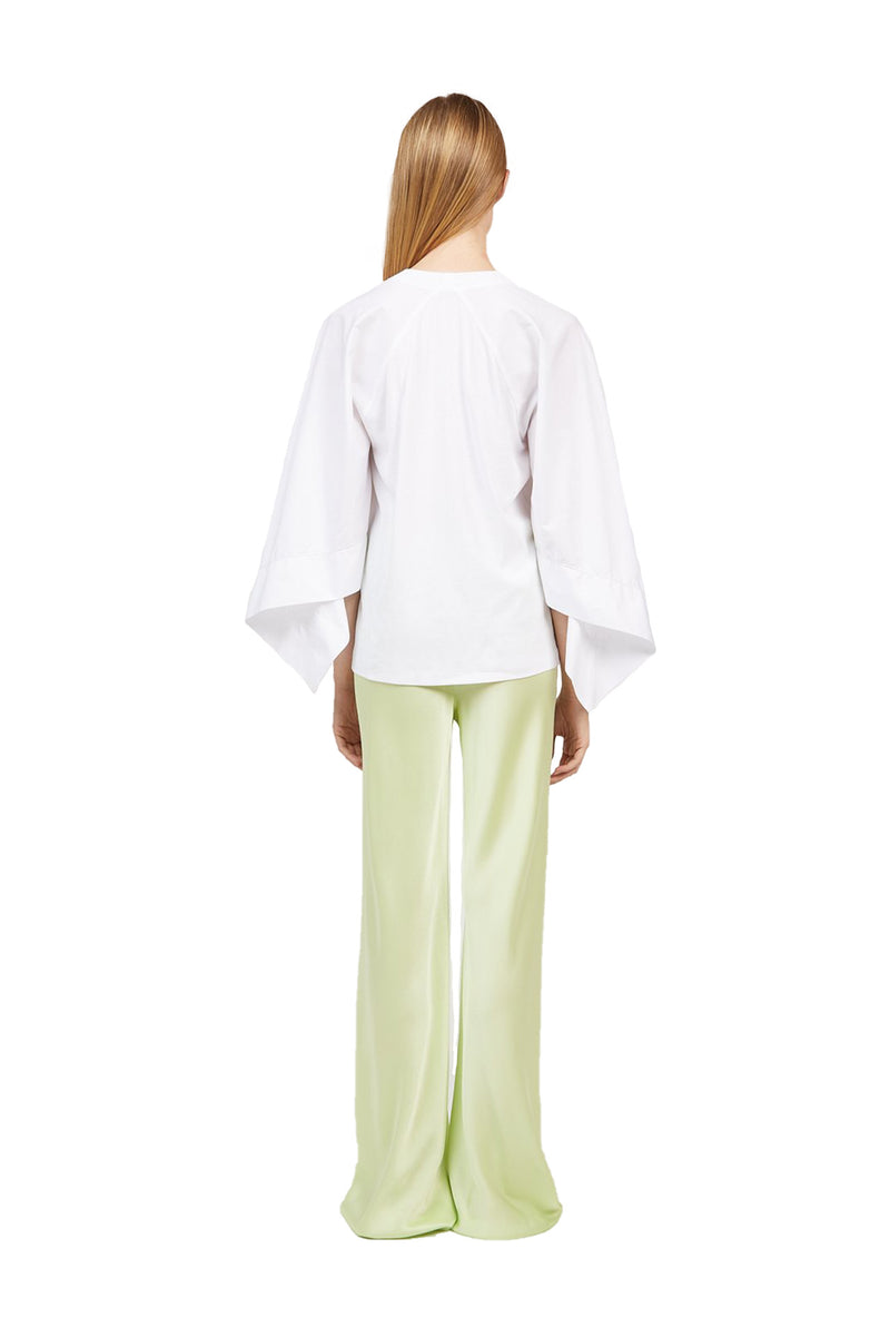 Back view of Lime colored Bias Trousers paired with a white dress shirt
