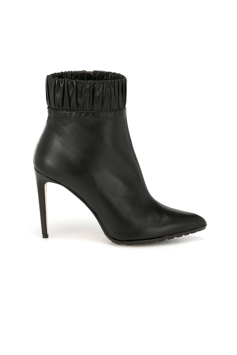 Black leather Maud booties by Chloe Gosselin