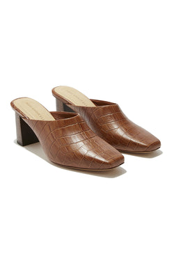 Brown croco embossed leather heeled mules by Mari Giudicelli